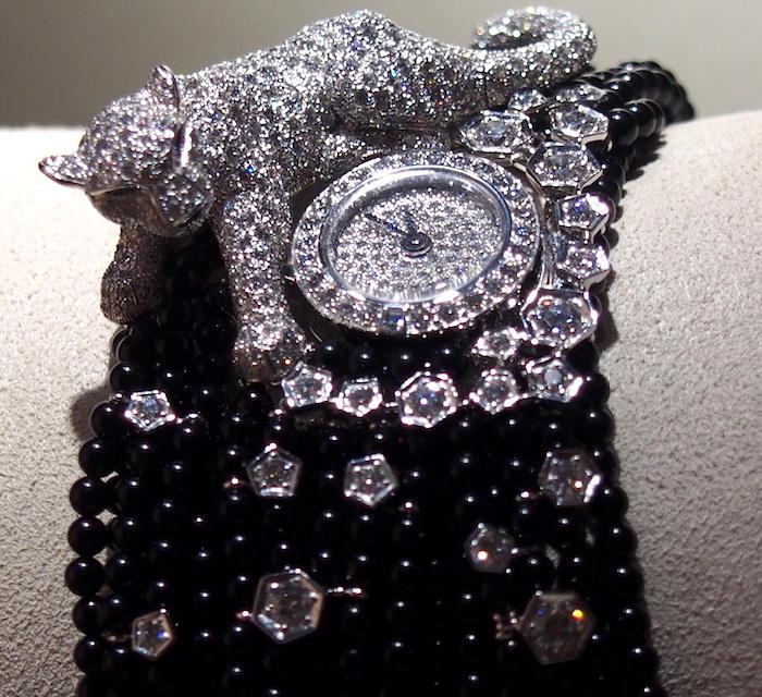 A crouching jewel on a gemstone bracelet.