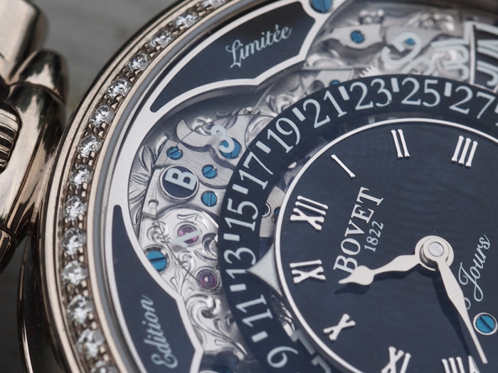 The engraving work is all hand done and is visible beneath the sapphire calendar  disks