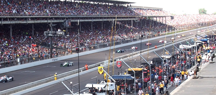The cars coming into the first turn