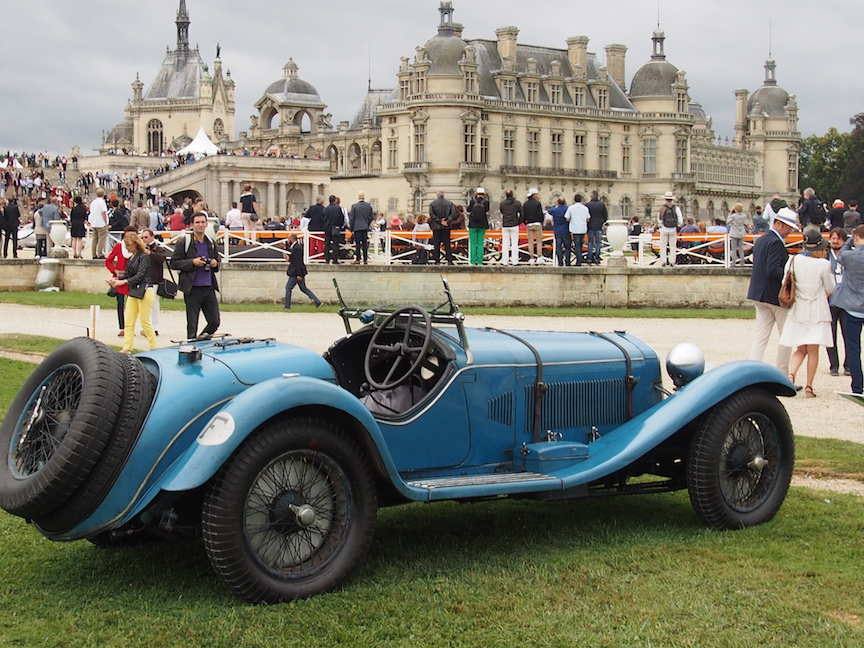 The chateau serves as the backdrop for the stunning vintage and concept cars on exhibit.
