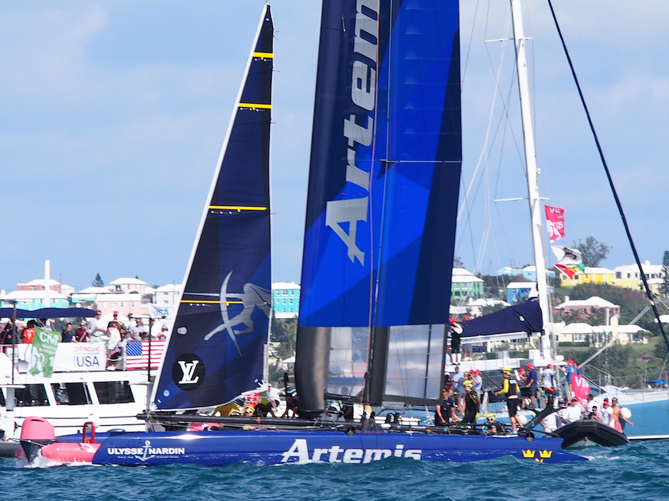 The small pink boat got lodged underneath the front of Artemis Racing