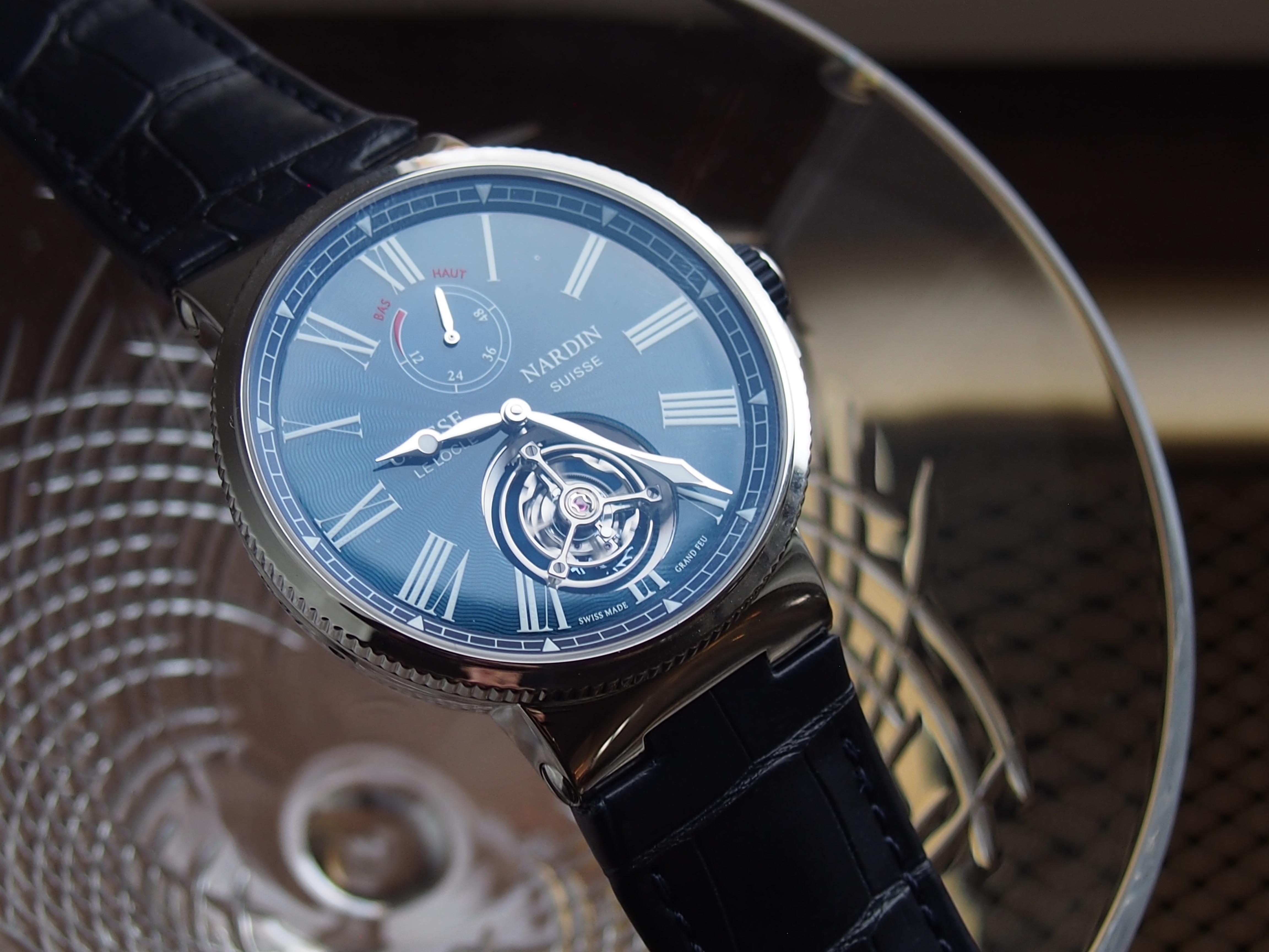 The Ulysse Nardin Marine Tourbillon Blue Grand Feu watch carries an amazing price point for a tourbillon.