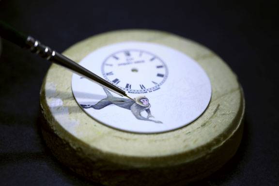 Hand painting on the ivory enamel dial is time consuming and exacting.