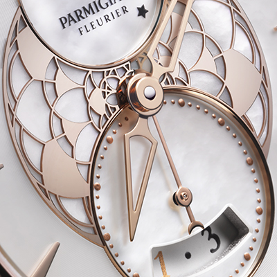 "TECHNICAL DETAILS REFERENCES MOVEMENT PFC283-1063300 PF318 Winding: Self-winding Power reserve: 50 hours Frequency: 4 Hz – 28,800 Vib/h Dimensions: 11 1⁄2''' – Ø 26.0 mm Thickness: 4.7 mm Components: 205 Jewels: 28 Barrel(s): 2 series-coupled barrels Decoration: ""Côtes de Genève"" decoration, bevelled bridges FUNCTIONS Hours, Minutes Small seconds Date Moon phase CASE Shape: Round, in 3 sections Dimensions: Ø 33.72 mm Thickness: 9.57 mm Material: 18 ct rose gold Number of diamonds: 76 Carats: 0.5200 Water resistance: 30 m Case-back: Sapphire Crystal: Anti-reflective sapphire Crown: Ø 5.5 mm Engraving on case-back: Individual number DIAL Material: White mother of pearl Indices: 18 ct rose gold appliques Finish: Snailed exterior, rose gold lace centre, opaline counters Hands: Skeleton Delta-shaped STRAP Gold: 18 ct rose gold Leather: Calfskin or 18 ct rose gold bracelet BUCKLE Type: Folding"