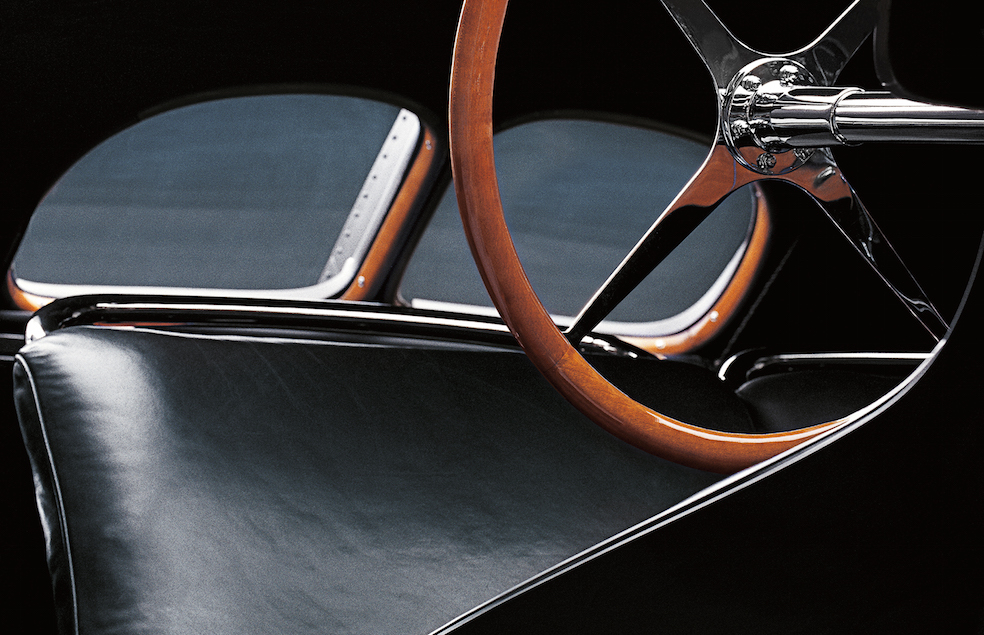 Amboyna burl used in Ralph Lauren's own 1938 Bugatti Type 57SC Atlantic Coupe is the wood of choice for the bezel on the Ralph Lauren Automotive Skeleton Steel 45mm watch.