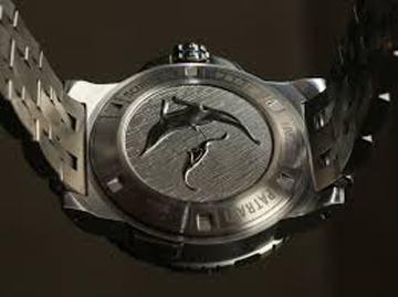 The watch features an engraved caseback emulating sea life.