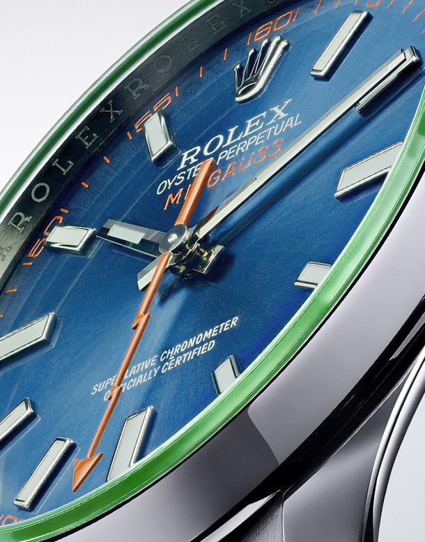 The watch features an orange lightning-bold seconds hand.