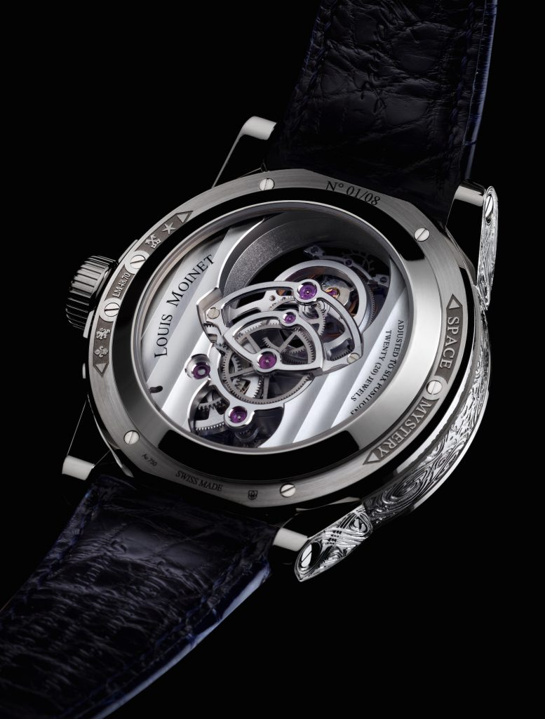 The caseback of the Louis Moinet Space Mystery watch reveals the tourbillon, as well.