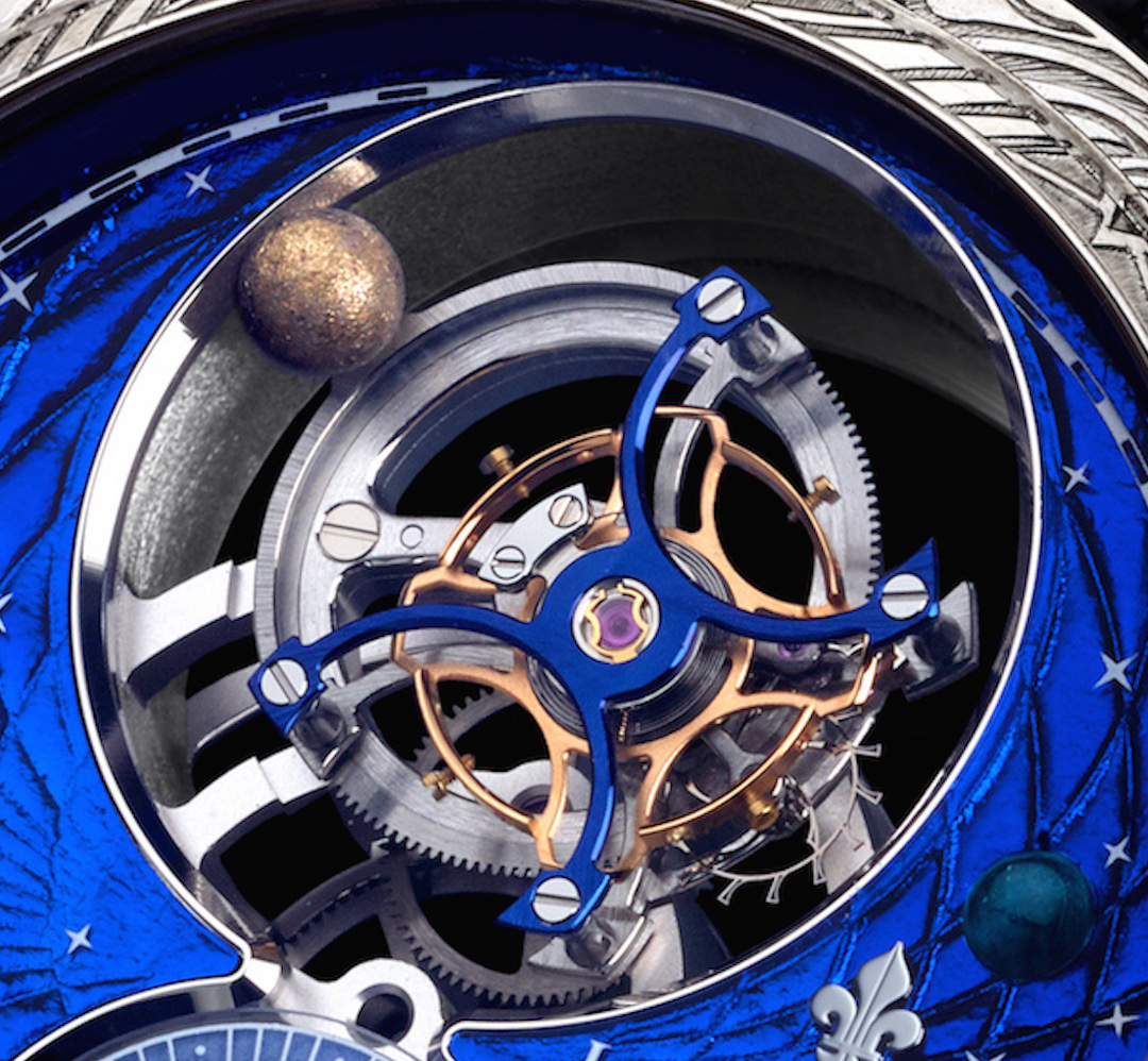 The over-sized tourbillon cage of the Louis Moinet Space Mystery watch is balanced by an orb that rotates around it, and the tourbillon also rotates.