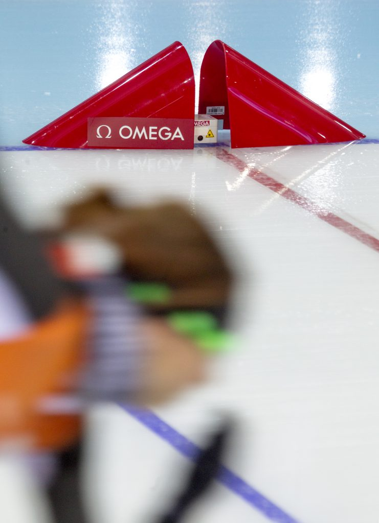 Speed skating at the Winter Olympics, timed by Omega.