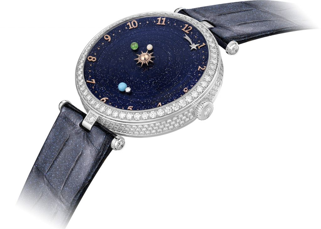 The Van Cleef & Arpels Lady Arpels Planetarium watch features three planets rotating around the sun.
