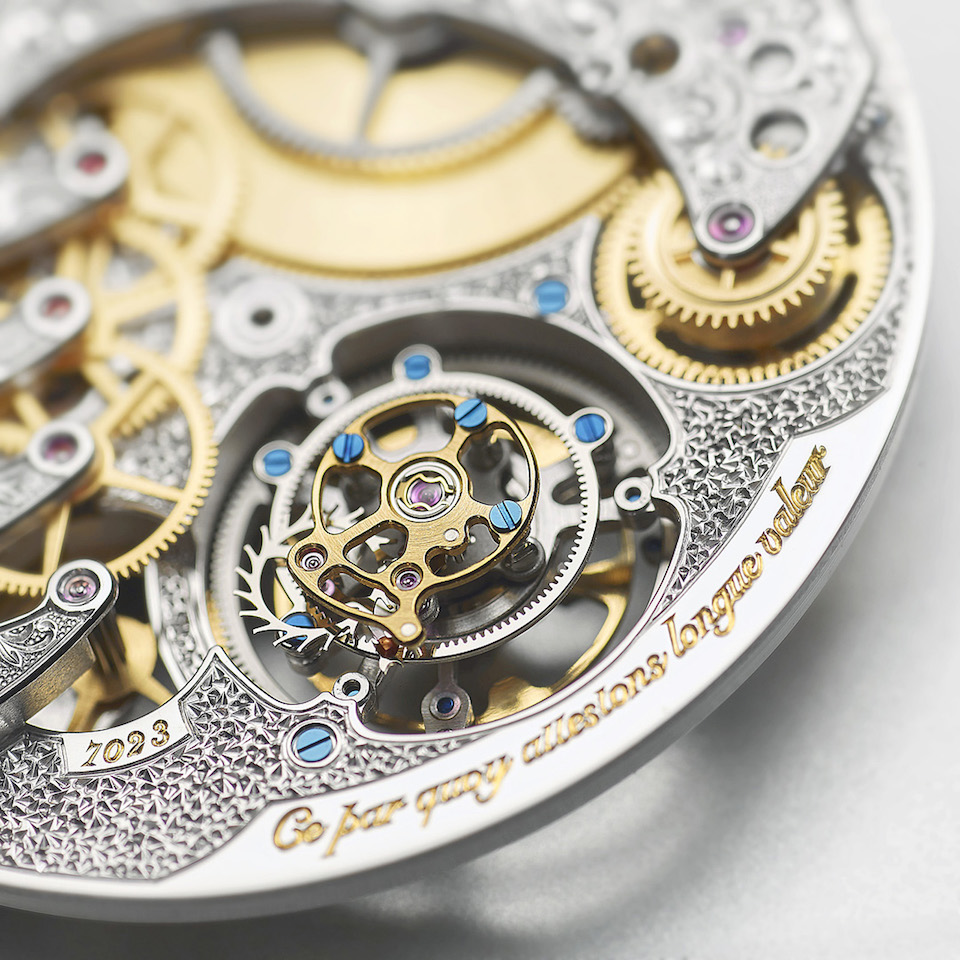The complex caliber carries three patents and features flying tourbillon with seconds hand.