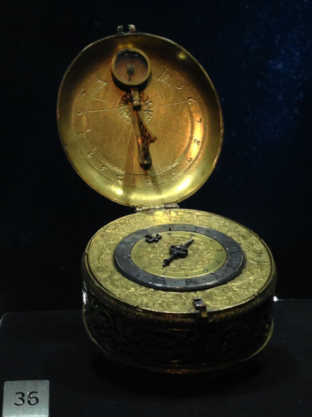 Pendant alarm watch circa 1590 in the form of a sundial with compass for setting time.