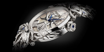 The design that emulates nature is created with gold, mother of pearl, diamonds and sapphires.