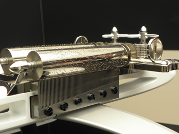 Hand craftsmanship of thousands of precisely placed pins and teeth enables the cylinders to play the tunes.