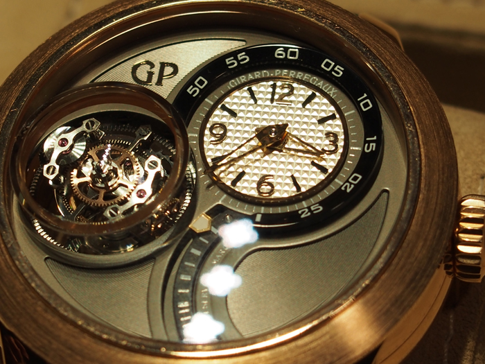 The triple axes of the Tri-Axial Tourbillon are all inside an inner sapphire container that protrudes from the watch dial.