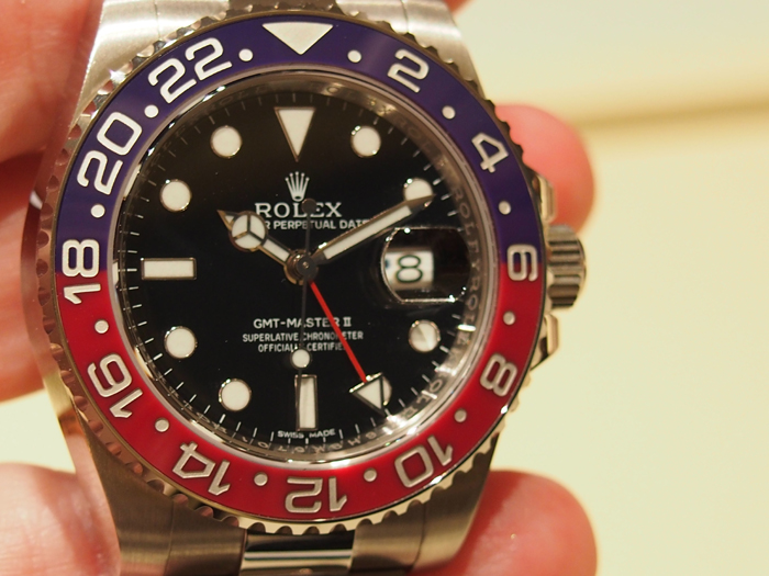 Rolex Oyster Perpetual GMT Master II watch features a distinctive red and blue Cerachrom bezel.