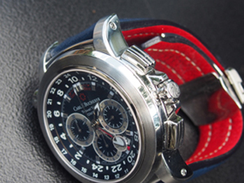 The blue dial and strap is accented with a red GMT hand and a red lining on the leather strap.