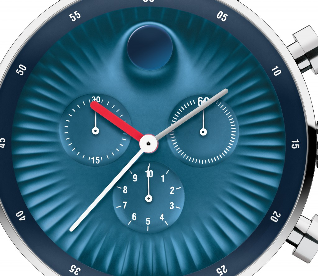The dial is concave, but the famed dot raises upward from the dial.