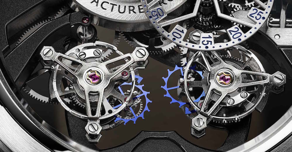 The two tourbillon escapements rotate at different speeds.
