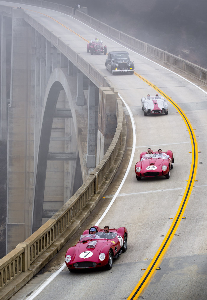 Participants in the Pebble Beach Tour d'Elegance cross the Bixby Bridge and head south on Highway 1