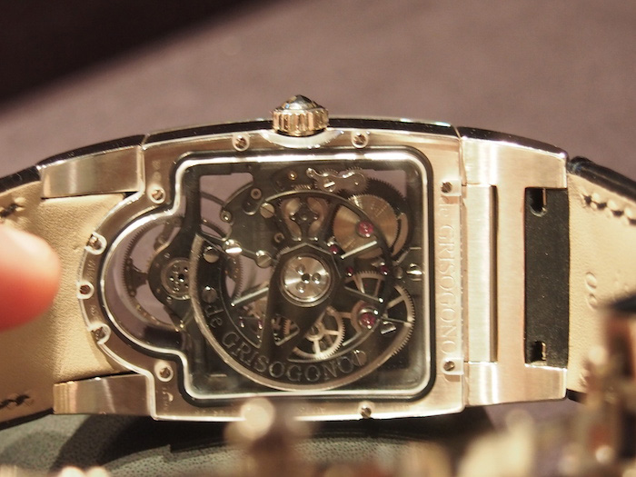 The 266-part movement is visible via the case back