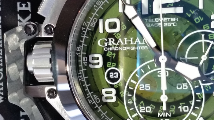 The automatic  watch features a green smoked crystal
