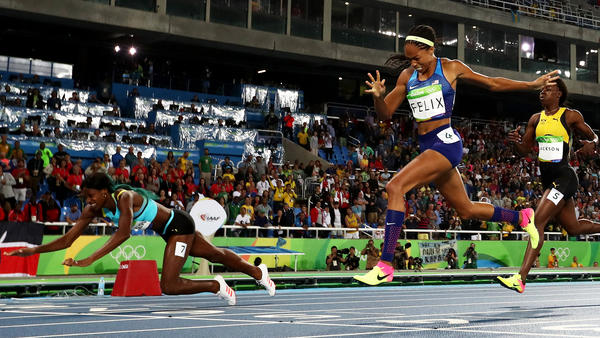 Women's 400M at Rio Summer Olympics has Miller diving to the finish to beat Felix