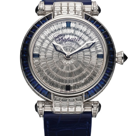 Chopard Ref. 4240 Imperiale White Gold Diamond & Sapphire. Sold in 2014, this is an extremely fine and very impressive, 18K white gold wristwatch set with baguette diamonds and baguette sapphires and an 18K white gold Chopard buckle set with 48 round diamonds and 10 calibrated baguette sapphires. Est. $200,000 to $300,000