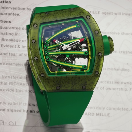 """Richard Mille RM 59-01 Yohan Blake Tourbillon Skeleton Composite, No. 40/50. Produced in 50 pieces in 2014, this is a very fine and unusual tonneau-shaped and curved asymmetric, skeletonized composite wristwatch with visible one minute tourbillon regulator and 42 hour power reserve.Yohan Blake nicknamed """"The Beast"""" is a medal-winning Olympic sprinter. He won a gold medal at the 100 m at the 2011 world championships as the youngest 100 m world champion ever, and a silver medal in the 2012 London Olympic Games in the 100 m and 200 m races for the Jamaican team. The RM 059 was developed in collaboration with Yohan and according to Richard Mille """"designed to be capable to cut through air"""" with its asymmetrical, streamlined and aerodynamic shape, resulting in the lowest possible drag coefficient"""