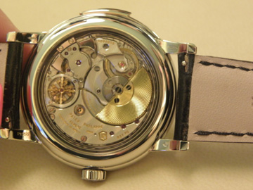A view of a Patek Philippe minute repeater movement through the caseback.