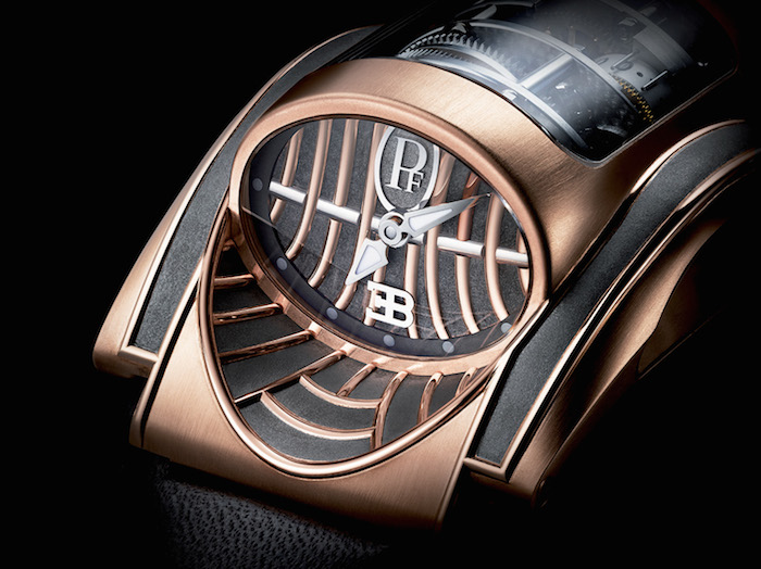 The Parmigiani Bugatti Mythe is crafted in 18-karat rose gold and the dial emulates the car grille.