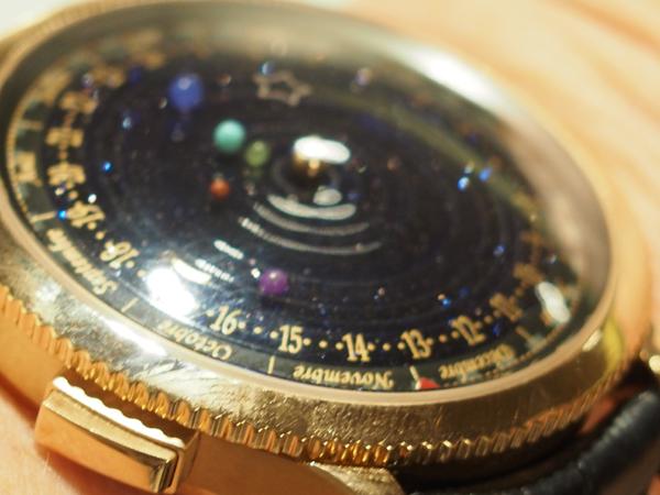 Van Cleef & Arpels Midnight Planetarium on the wrist.