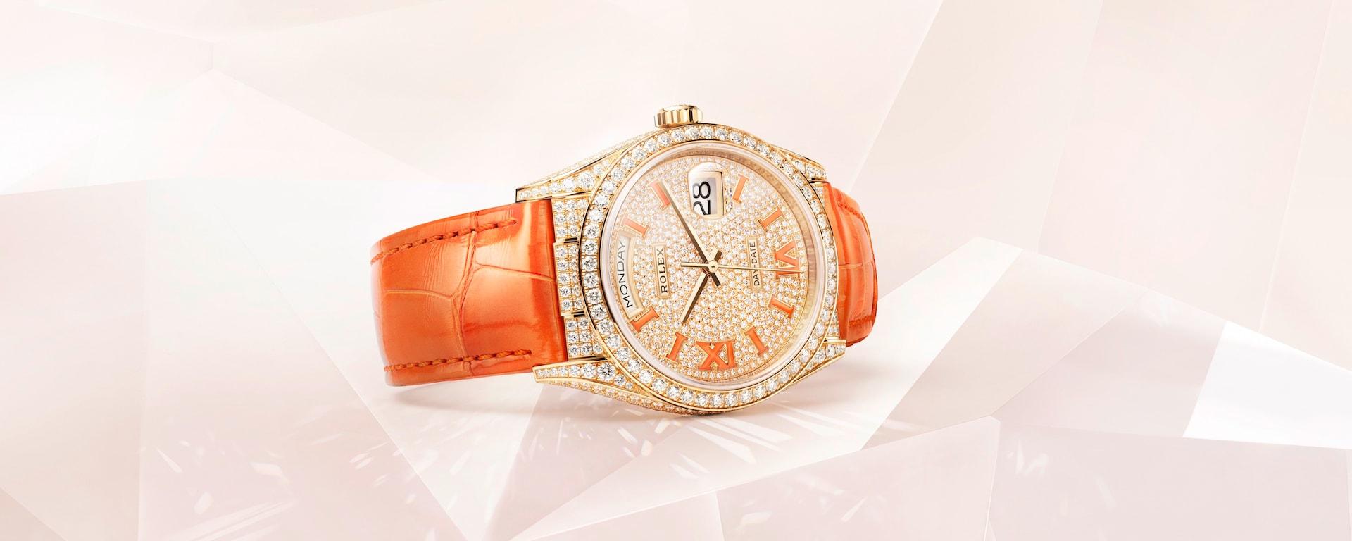 Rolex Day-Date 36mm in diamonds and bold orange.