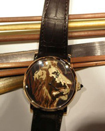 Marquetry lion motif dial consisint of hundreds of pieces of wood.