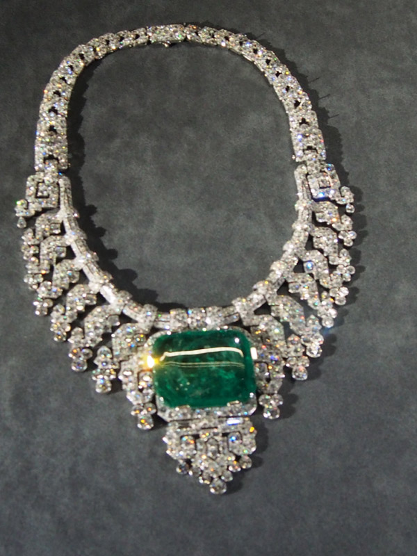 Platinum and diamond necklace with center emerald. Total 143.23 carats. Circa 1932.
