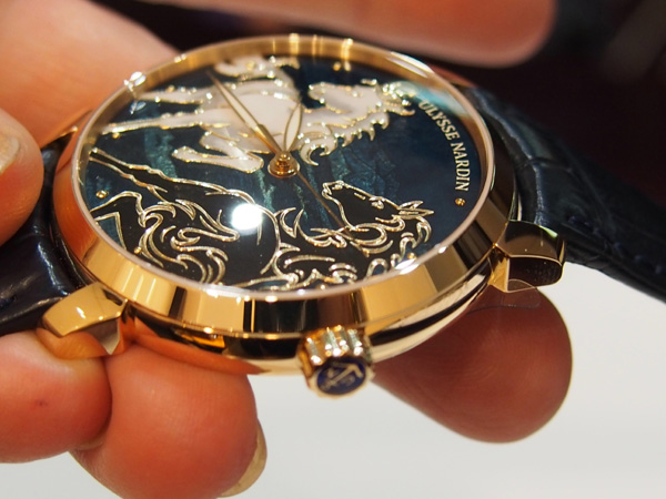 The champleve enamel work, wherein the dial is chiseled away and enamel is painted into place, offers incredible depth and dimension.