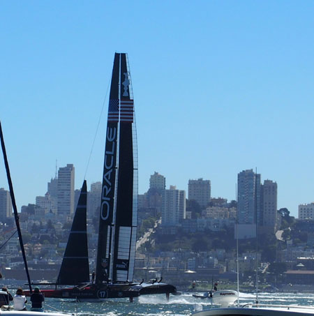 The new 72-foot wing sail catamarans seem to fly out of the water at great speeds.