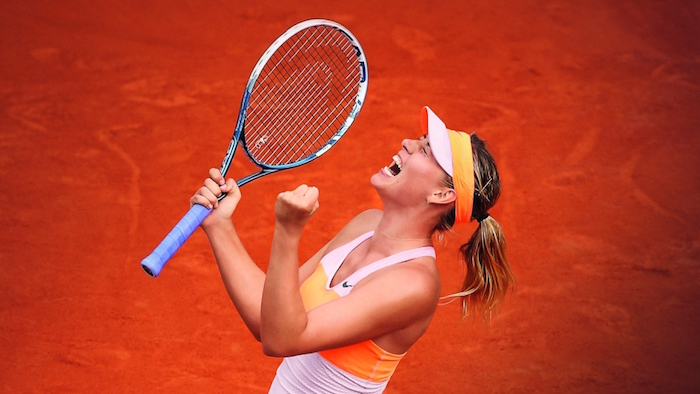 Maria Sharapova of Russia celebrates a point during her women's singles final match against Simona Halep of Romania on day fourteen of the French Open