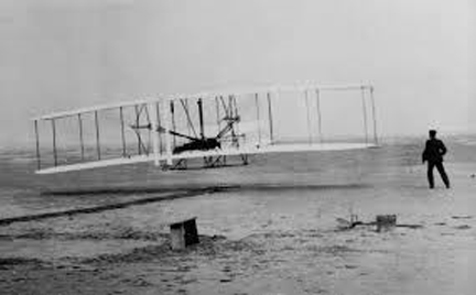 The Wright Brothers at Kitty Hawk.