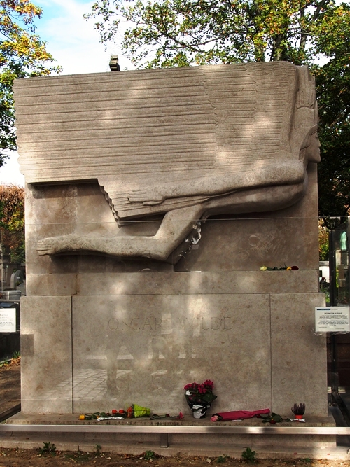 Oscar Wilde's Grave at Pere Lachaise often has red lipstick kisses on it.