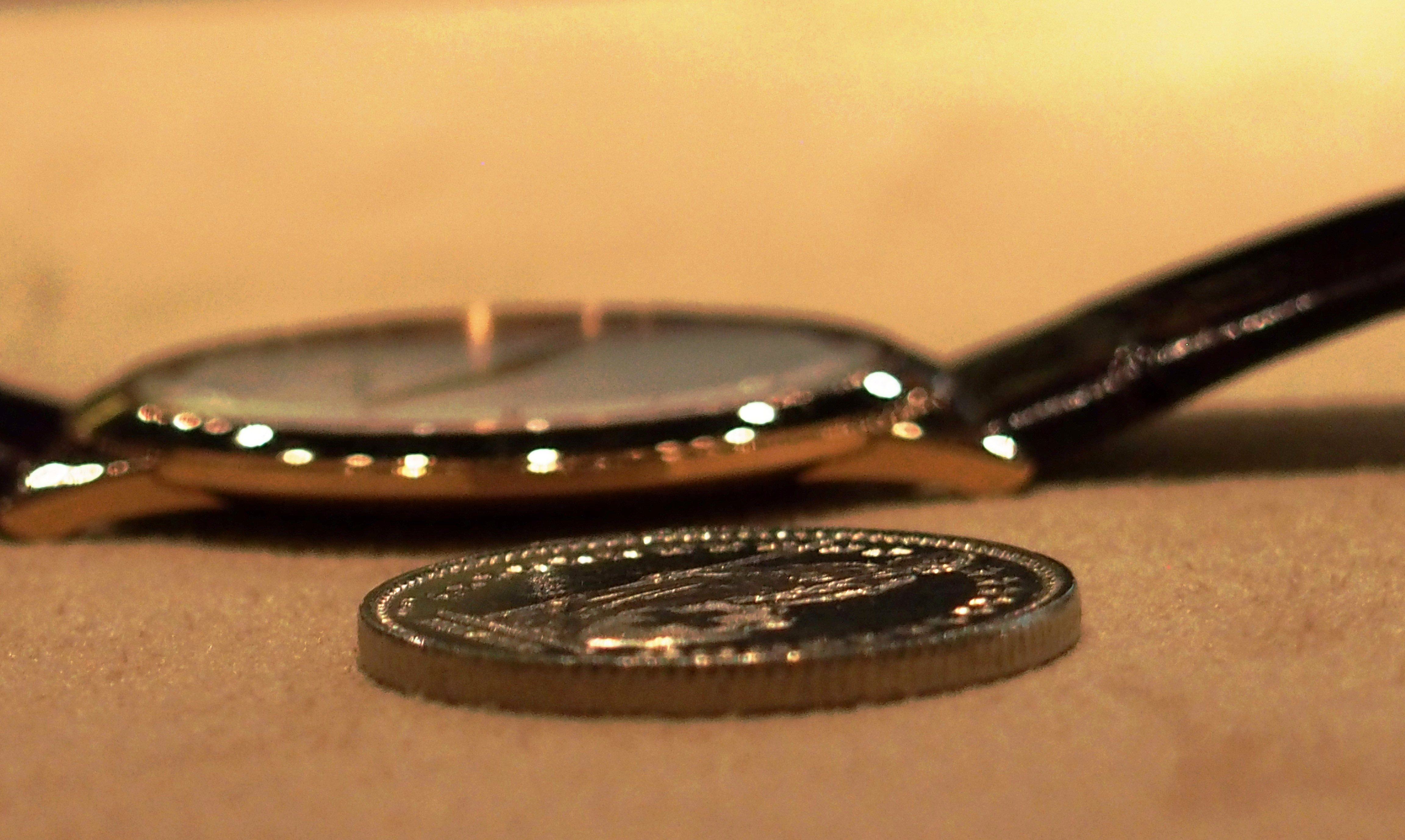 Jaeger-LeCoultre Master Ultra Thin 1907 next to a Swiss  coin.