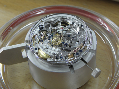 A watch movement outside of its case (Zenith).